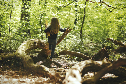 Girl playing in forest - SBOF000132