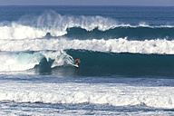 Indonesia, Bali, Surfer on a wave - KNTF000380