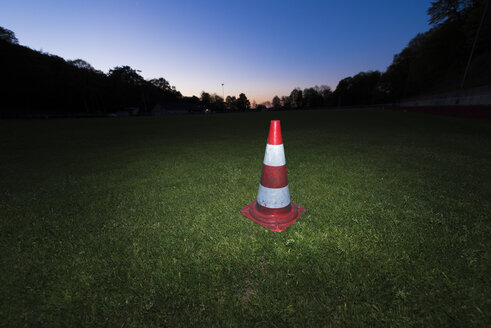 Germany, Traffic warning cone on a soccer field - SKAF000021
