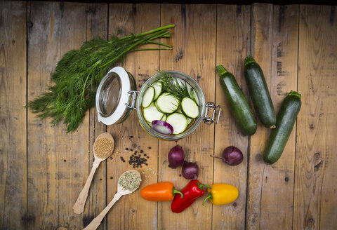 Glass of pickled courgette and bell pepper, preparation with different spices - LVF004984