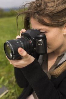 Woman photographing in nature - BOYF000444