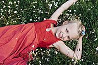 Smiling girl lying in flower meadow - MJF001926