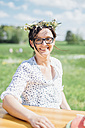 Portrait of smiling woman wearing flower wreath - MJF001929