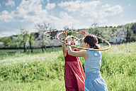 Two girls with hula hoops in meadow - MJF001932