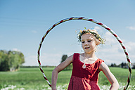 Girl with hula hoop wearing flower wreath - MJF001935
