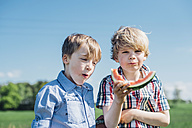 Two boys outdoors eating watermelon - MJF001938