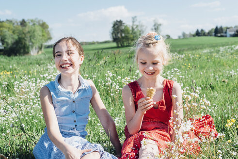 Two girls in meadow with ice cream cone - MJF001953