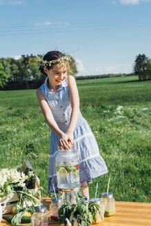 Smiling girl wearing flower wreath on meadow - MJF001959