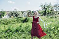 Happy girl with ribbon in meadow - MJF001962