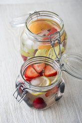Two jars of cooled water flavoured with different fruits - MYF001598