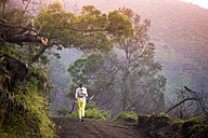 Indonesia, Java, Woman hiking in mountains - KNTF000391