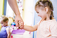 Father and daughter holding hands - HAPF000506
