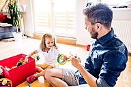 Father and daughter playing together with toys - HAPF000524