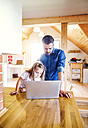 Father and daughter using laptop at home - HAPF000527