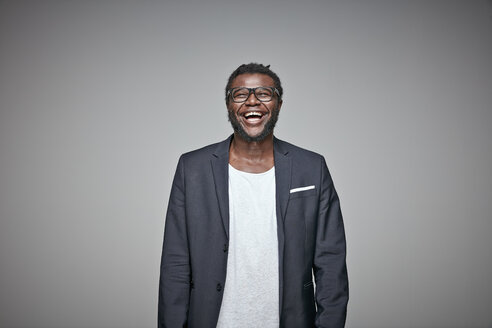Portrait of laughing man wearing glasses and jacket - RHF001673