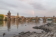 Czech Republic, Prague, Rainbow over Charles Bridge at sunset - MELF000128