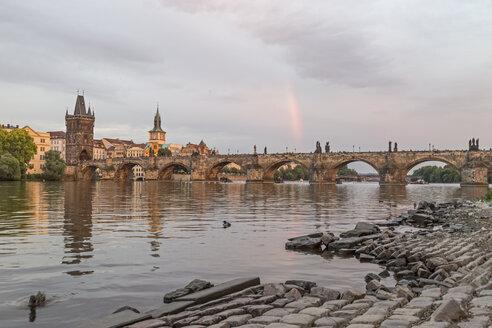 Czech Republic, Prague, Rainbow over Charles Bridge at sunset - MELF000128