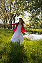 Girl dancing on a meadow - SARF002802