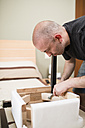 Man assembling furniture at home - RAEF001243