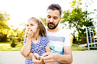 Father and his little daughter together in a park - HAPF000550