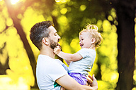 Father holding little daughter on his arms - HAPF000562