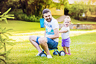 Father and his little daughter with toy car in a park - HAPF000565