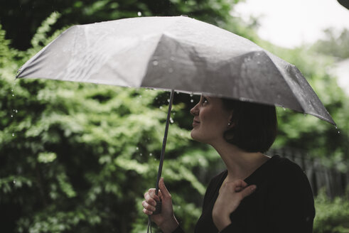 Woman with umbrella on a rainy day - DASF000049