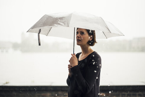 Woman with umbrella on a rainy day - DASF000052