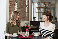 Two best friends sitting in a coffee shop - KAF000168
