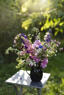 Summer flowers in vase, lupine, hollyhock, cornflower, lady's mantle and bellflower - MYF001663