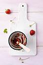 Empty strawberry jam, wooden spoon - MYF001669