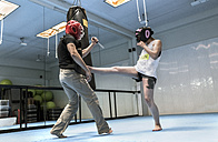 Young woman in gym doing self defense training - MGOF002022
