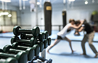 Young woman in gym doing self defense training - MGOF002025