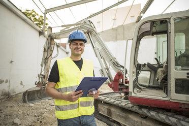 Construction worker near to the caterpillar - JASF000877