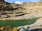 Oman, Wadi Damm, two young woman swimming - AMF004944