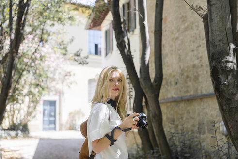 Portrait of blond woman with camera - FMOF000048