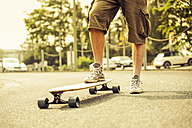 Man with longboard, partial view - SKAF000023
