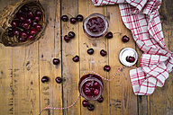 Two glasses of homemade cherry groats and cherries on wood - LVF005066