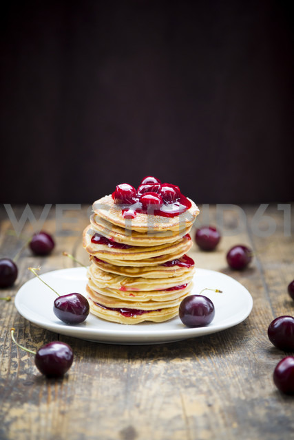 Stack of American pancakes with cherries and cherry groats - LVF005078