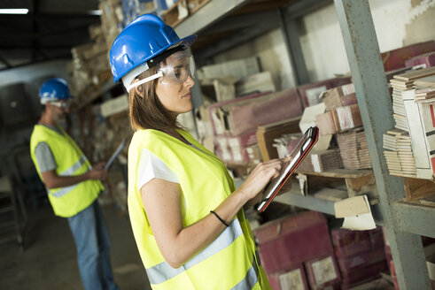 Woman is taking stock in warehouse of construction company - JASF000971