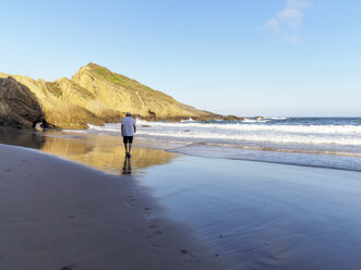 Portugal, Senior man taking a stroll at the beach - LAF001689