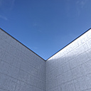 High concrete wall in front of blue sky, 3D Rendering - UW000913