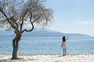 Greece, Sergoulas, woman taking pictures with smartphone at the coast - DEGF000901