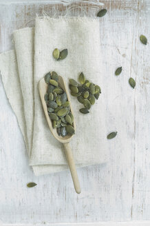 Wooden shovel of pumpkin seed on cloth and wood - ASF005927