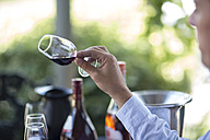 Man holding and judging glass of red wine - ZEF008912