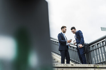 Two businessman talking in the city - UUF008016