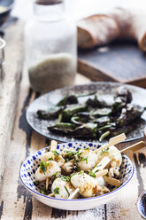 Different tapas, grilled sepia and pimientos de padron - SBDF003021