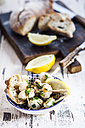 Tapas, grilled sepia, lemon and bread in bowl - SBDF003024