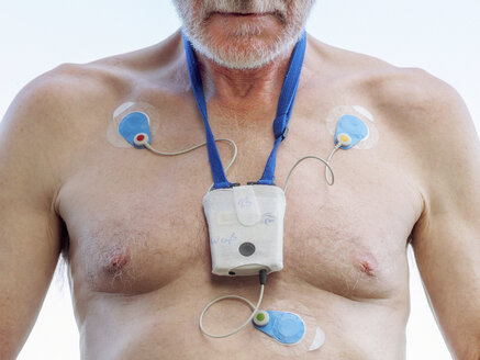 Senior man with long-term ECG on his chest, close up - LAF001703