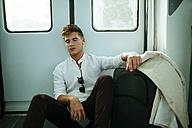 Young man sleeping on a train - KIJF000552